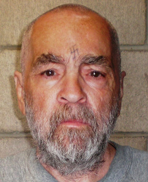 In this handout photo from the California Department of Corrections and Rehabilitation, Charles Manson, 74, poses for a photo on March 18, 2009 at Corcoran State Prison, California.