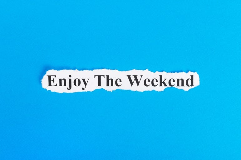 enjoy the weekend text on paper. Word enjoy the weekend on torn paper. Concept Image.