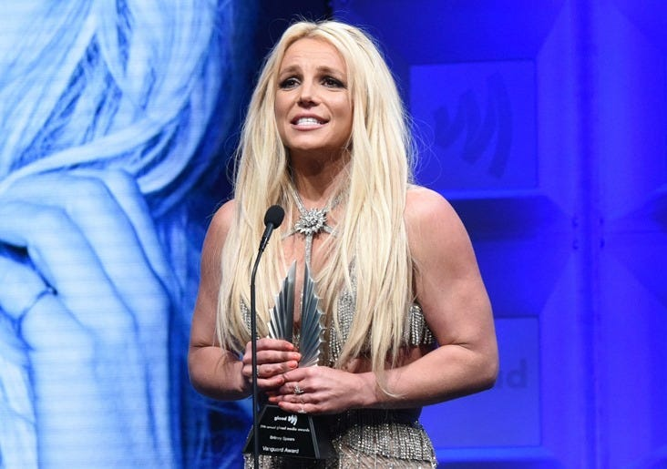 29th Annual GLAAD Media Awards Los Angeles - Dinner and Show BEVERLY HILLS, CA - APRIL 12: Honoree Britney Spears accepts the Vanguard Award from Ricky Martin and J.J. Totah onstage at the 29th Annual GLAAD Media Awards at The Beverly Hilton Hotel on Apri