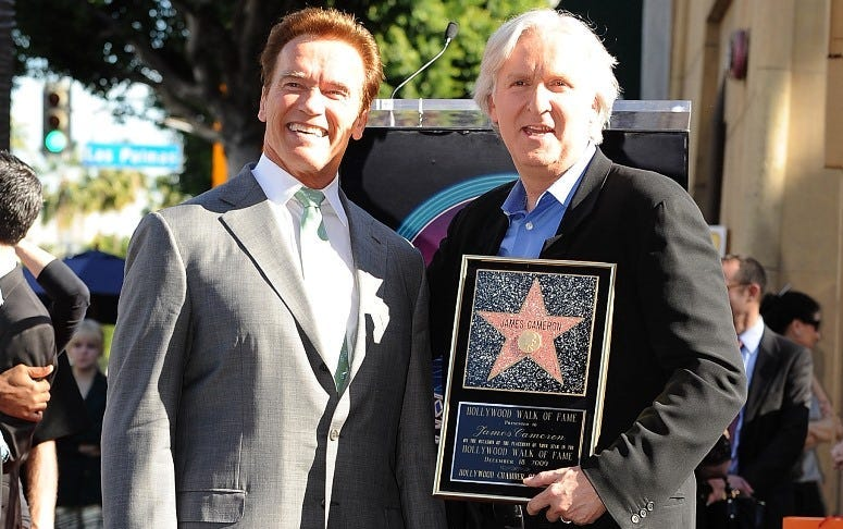 Arnold Schwarzenegger poses with Director James Cameron who was honored on The Hollywood Walk Of Fame with his own star on December 18, 2009 in Hollywood, California