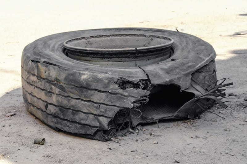 Blown out tire on side of highway
