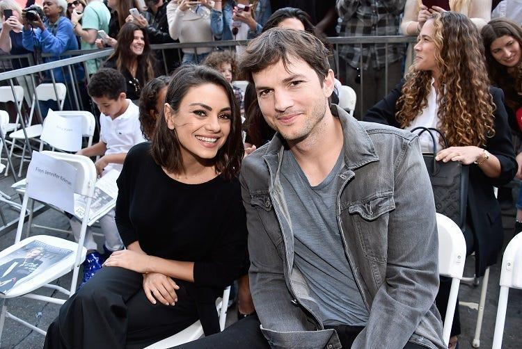Actors Mila Kunis (L) and Ashton Kutcher at the Zoe Saldana Walk Of Fame Star Ceremony on May 3, 2018 in Hollywood, California.