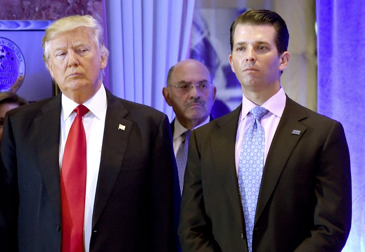 File photo: US President-elect Donald Trump along with his son Donald, Jr., arrive for a press conference at Trump Tower in New York, as Allen Weisselberg (C), chief financial officer of The Trump, looks on January 11, 2017