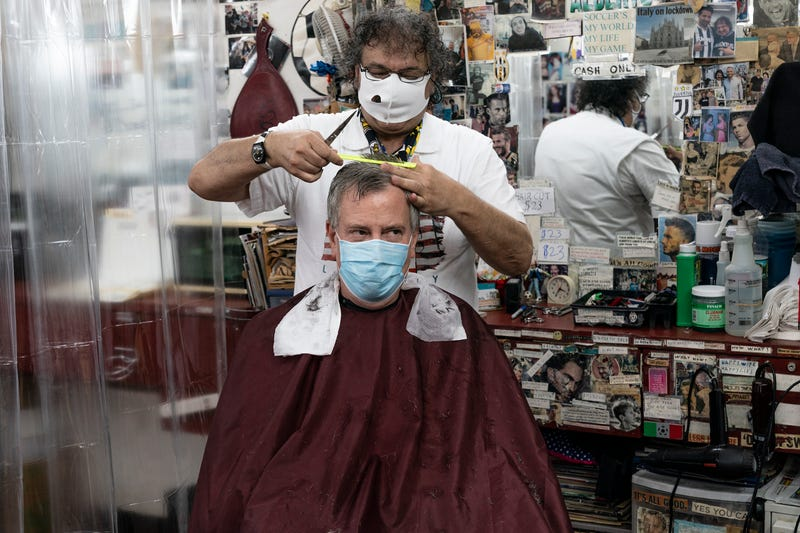 Mayor Bill de Blasio gets his hair cut by barber Alberto Amore at Astor Place Hairstylists on June 23, 2020.