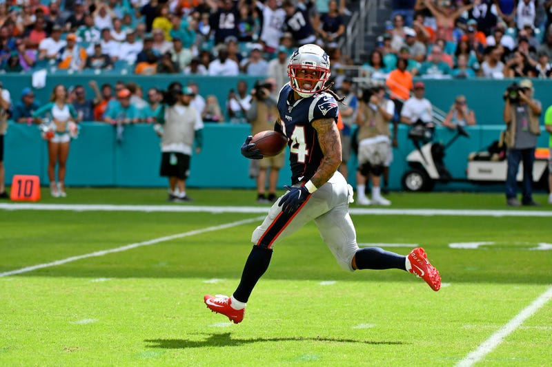 Sep 15, 2019; Miami Gardens, FL, USA; New England Patriots cornerback Stephon Gilmore (24) runs back an interception for a touchdown against the Miami Dolphins during the second half at Hard Rock Stadium. Mandatory Credit: Jasen Vinlove-USA TODAY Sports