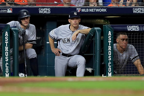 Joe Girardi watches from the dugout in the 2017 ALCS.