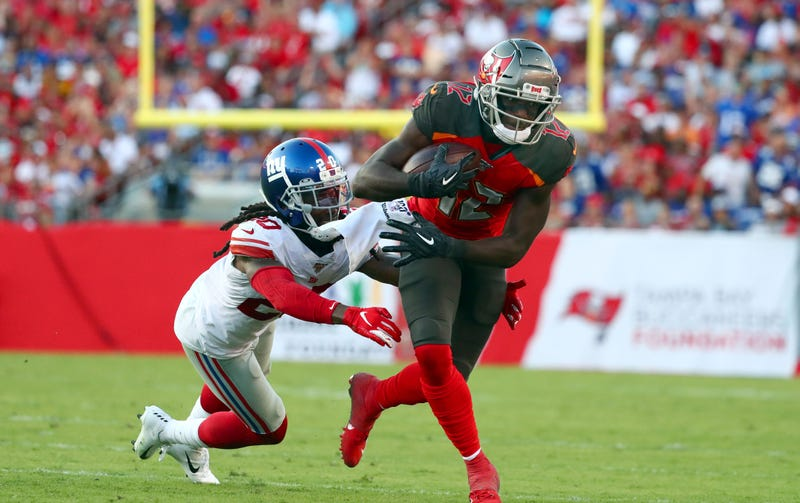 Chris Godwin avoids a tackle against the Giants in Week 3.