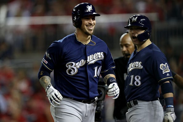 Yasmani Grandal celebrates a home run with the Brewers.