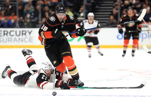 Derek Grant evades a defenseman as he chases down the puck.
