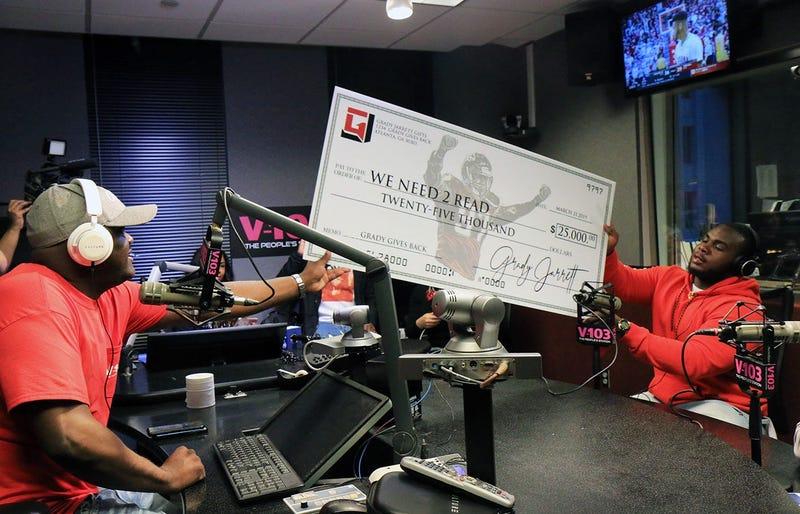 Greg Street receives $25,000 donation from Atlanta Falcons player Grady Jarrett for his We Need 2 Read program
