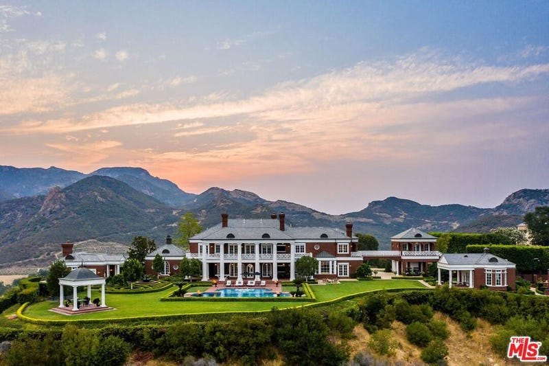 A wide shot of Wayne Gretzky's mansion with the Santa Monica Mountains