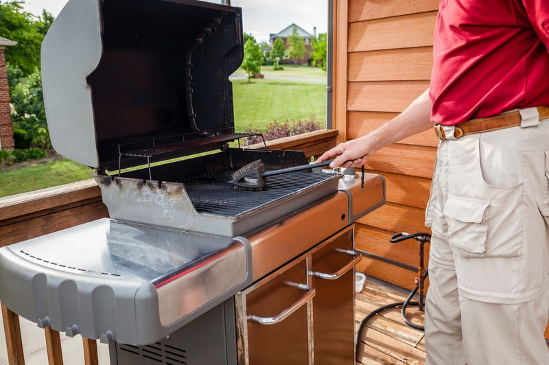 A man cleaning his grill