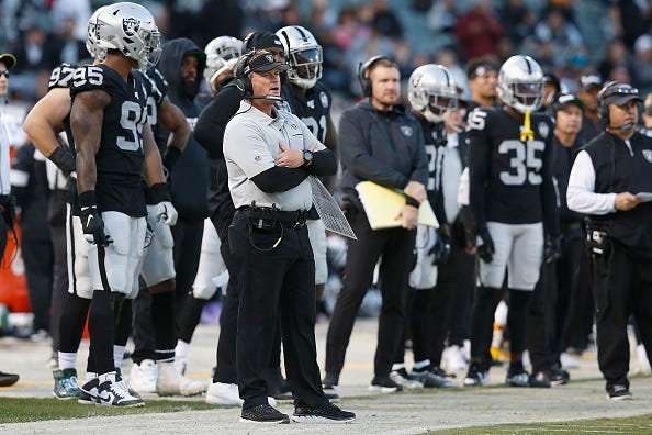 Jon Gruden commands the Raiders from the sideline.