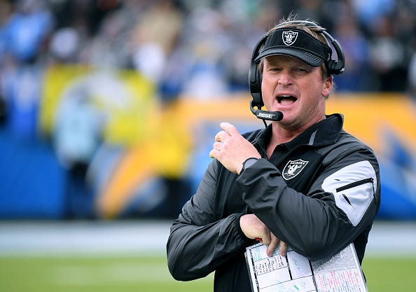 Jon Gruden shouts across the field before a Raiders game.