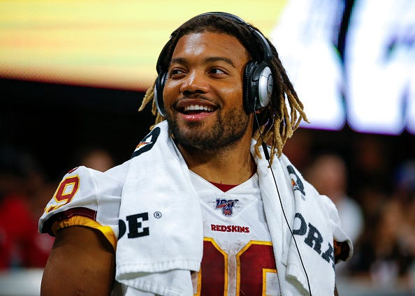 Redskins RB Derrius Guice listens to music before a preseason game.