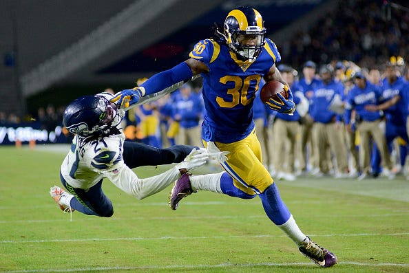 Rams RB Todd Gurley breaks a tackle.