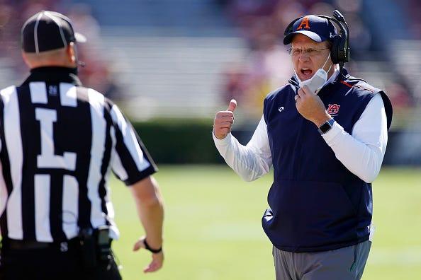 Gus Malzahn argues with an official during an Auburn game.