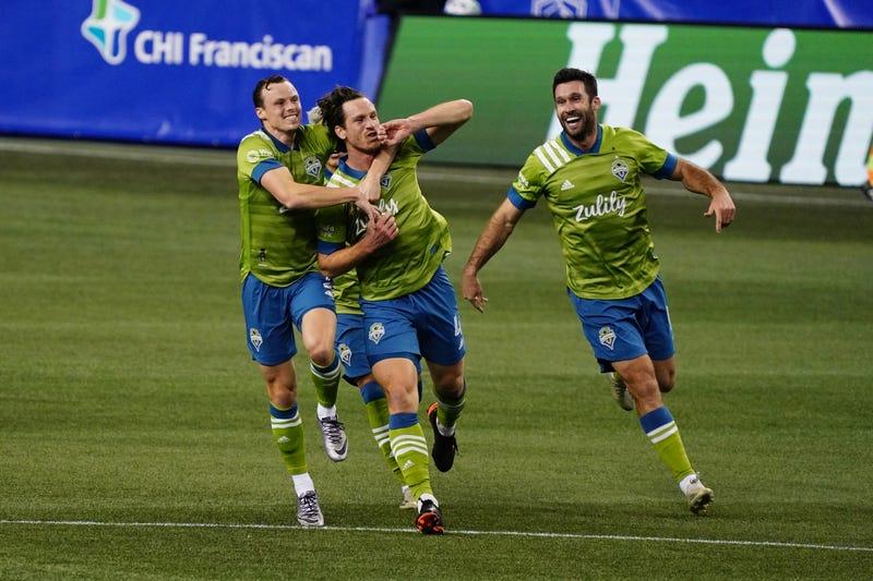 Sounders FC celebrate winning goal scored by Gustav Svensson