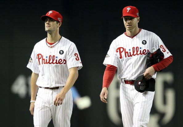 Cole Hamels and Roy Halladay at the 2011 MLB All-Star Game.