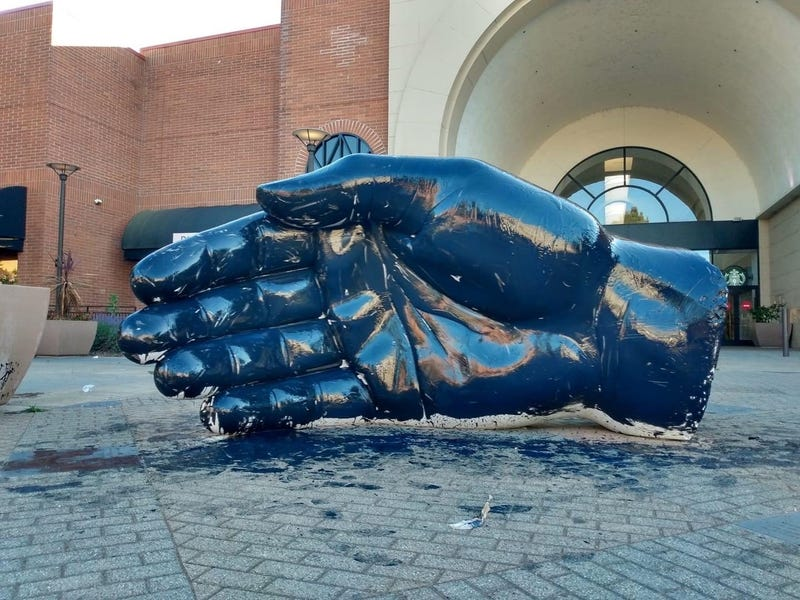 Black Lives Matter protesters painted a hand sculpture black in downtown Santa Rosa over the weekend.
