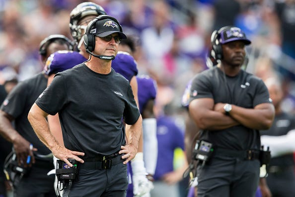 John Harbaugh looks on from the Ravens sideline.