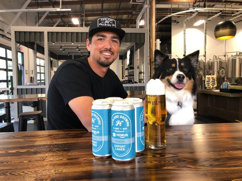 Harland Head Brewer Ryan Alvarez and Koda share a Harland Export Lager