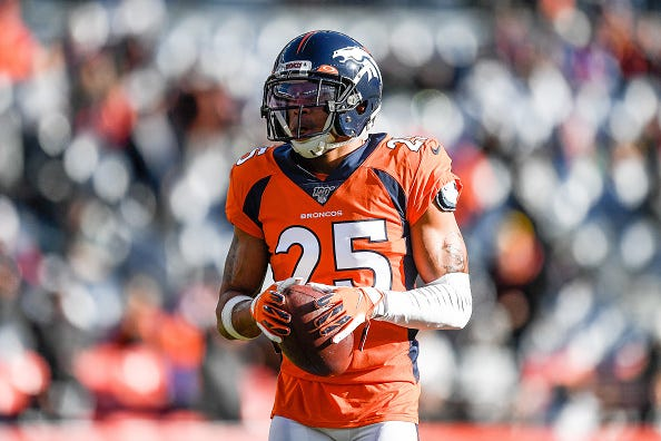 Chris Harris warms up before a Broncos game.