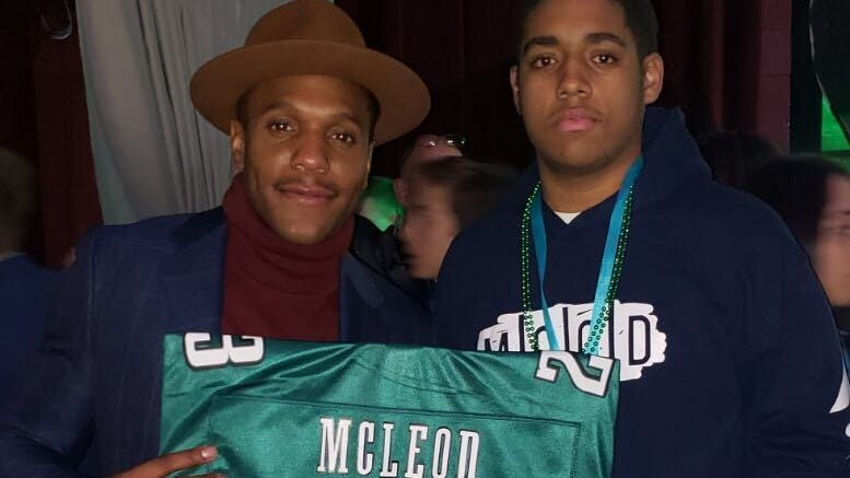 Eagles player Rodney McLeod and Isaiah Harris of Germantown at the 2018 Fashion Touchdown