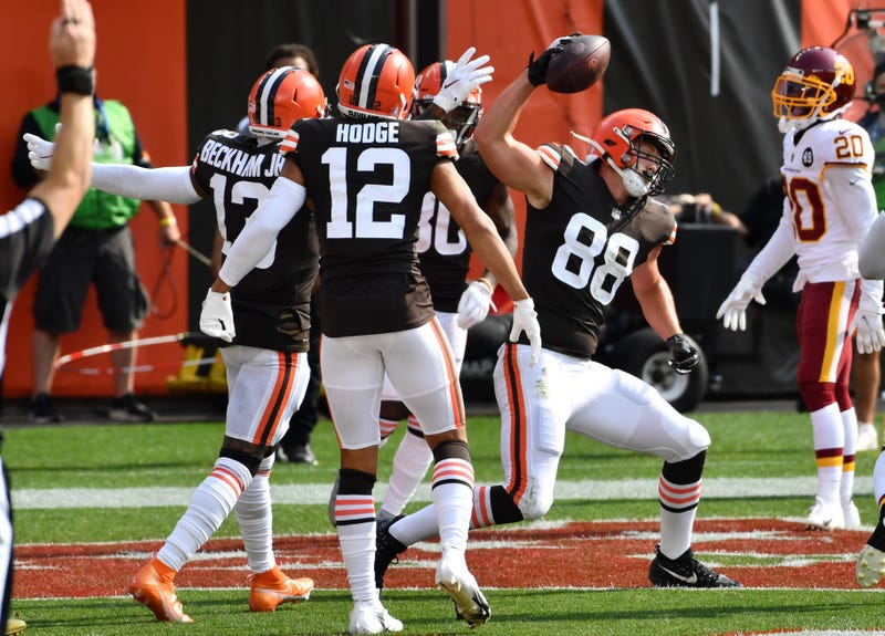 Cleveland Browns tight end Harrison Bryant spikes the ball after catching a touchdown during the second half against the Washington Football Team at FirstEnergy Stadium.