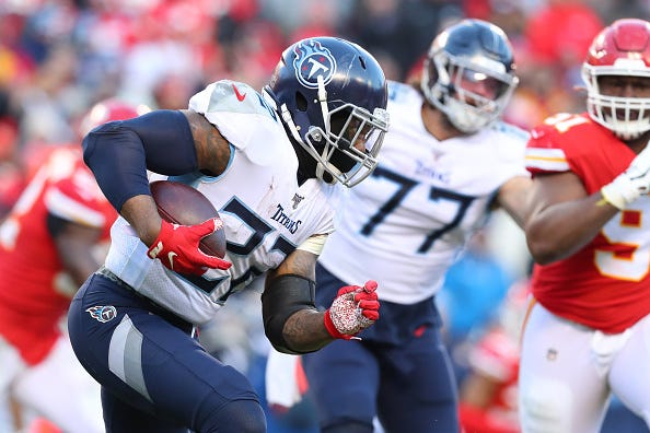 Derrick Henry looks for a lane to run with the Tennessee Titans.