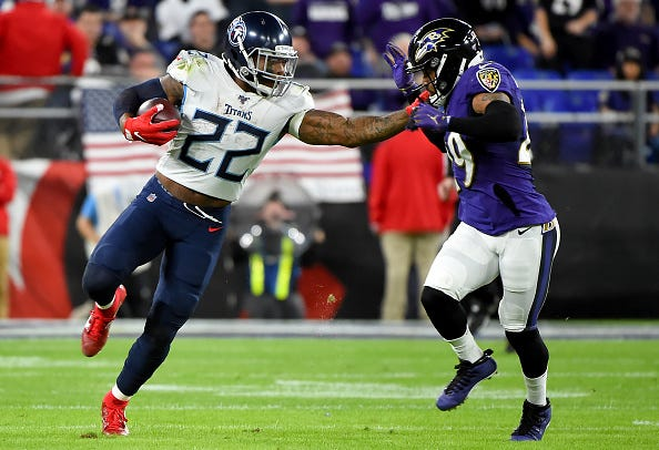 Titans RB Derrick Henry stiff arms Earl Thomas out of the way on a big run.