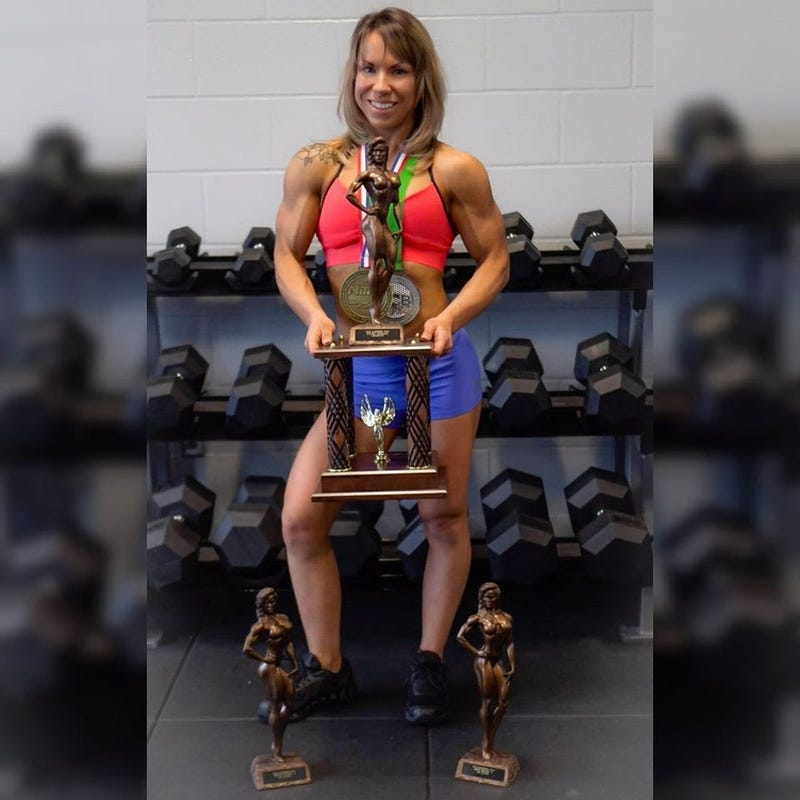 Hillery Dennies, a professional bodybuilder from Akron, poses with a trophy. (Photo courtesy of Hillery Dennies)
