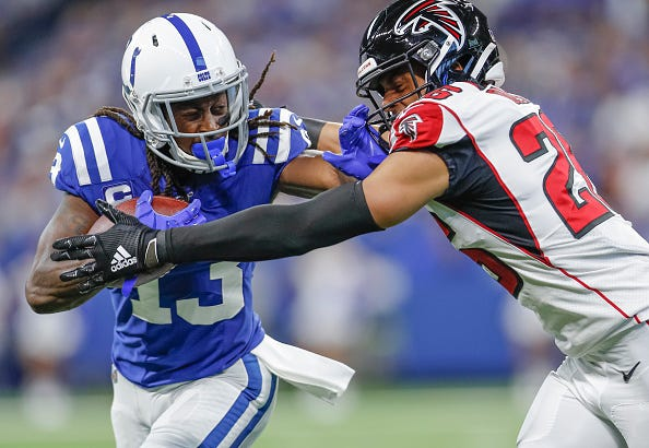 T.Y. Hilton throws a stiff arm on a Falcons safety in Week 3.