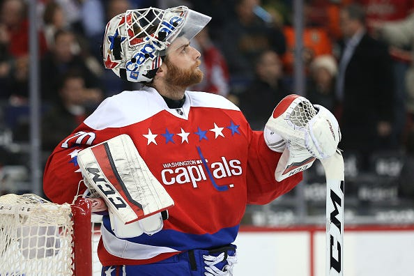 Braden Holtby gazes at the scoreboard during a Capitals game.