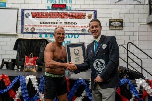 Marine veteran George Hood sets world record for planking
