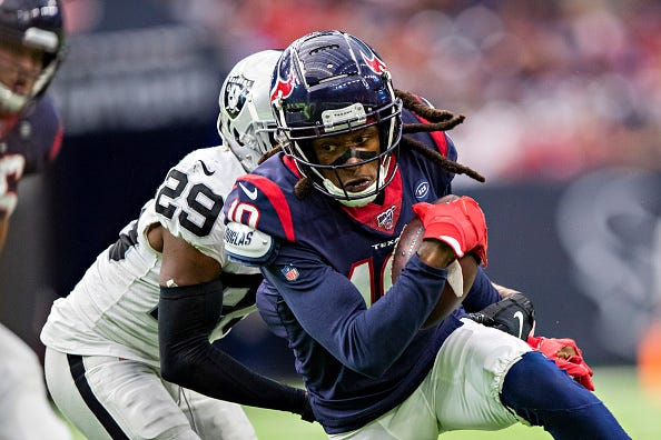 Texans WR DeAndre Hopkins fights for extra yards.