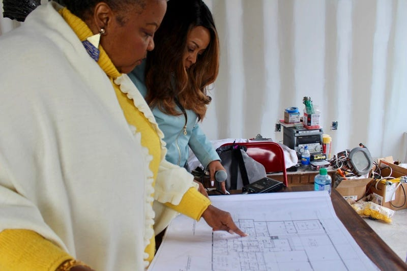 Elisabeth Omilami goes over floor plans for the new Hosea Helps facility in southwest Atlanta