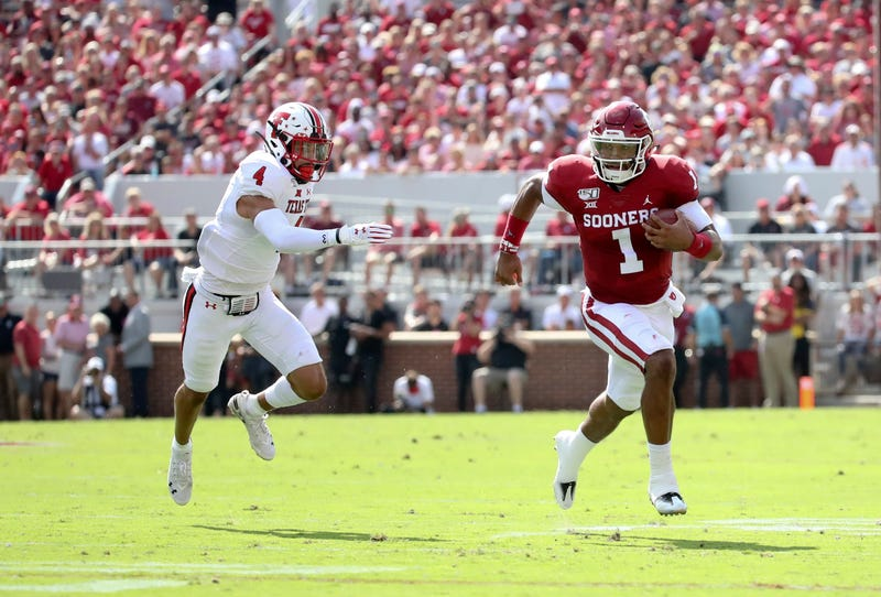 Oklahoma QB Jalen Hurts rushes for yardage against Texas Tech.
