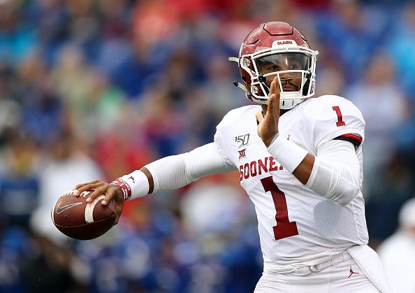 Oklahoma QB Jalen Hurts looks for a receiver downfield.