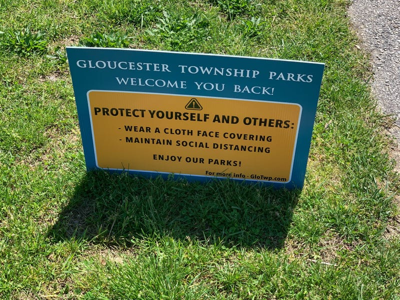 A sign at a Gloucester Township park welcoming people back, as parks and golf courses in New Jersey reopened Saturday, with strict social distancing requirements.