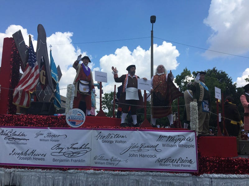 A float featuring the nation's founders is in the 2019 Independence Day Parade.