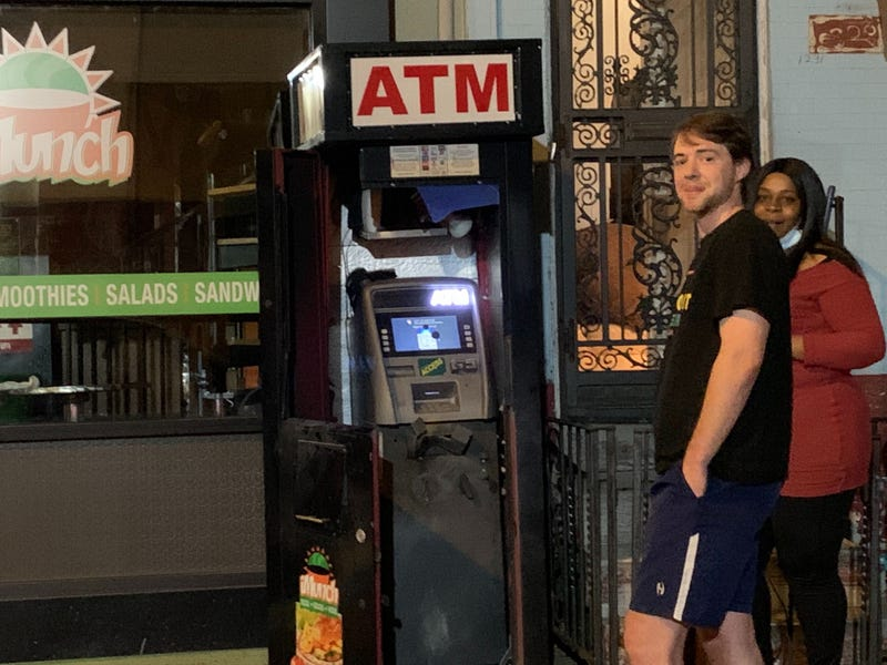 Brewerytown residents Lorette Willis and Marc Rademaker heard explosions overnight as looters tried to blow up ATMs.