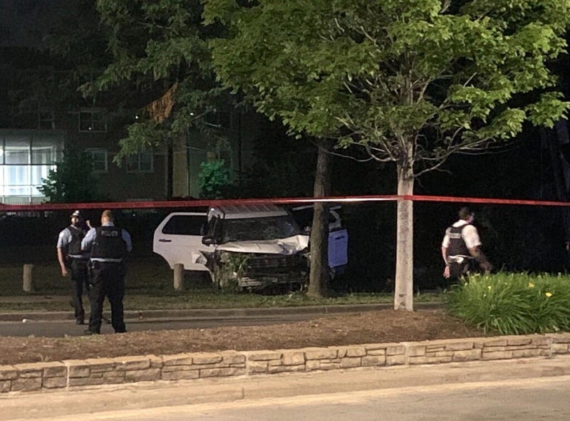 Chicago police investigate a scene where a man on a motorized scooter was fatally struck by an unmarked CPD vehicle July 8, 2020, in the 11800 block of South Halsted Street.