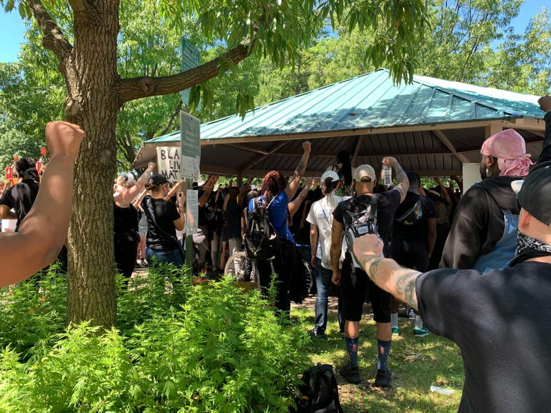 Protesters at Malcolm X Park in West Philadelphia called for an end to police in schools, as well as slashing police funding.