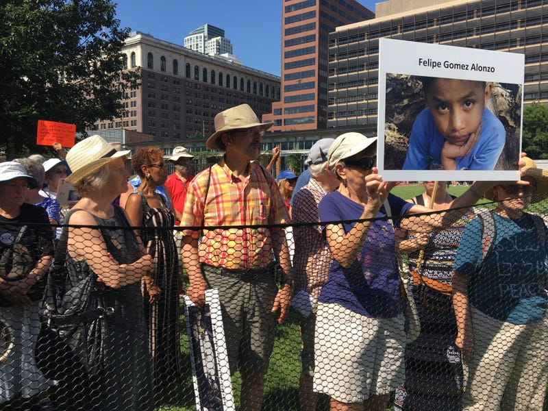 Dozens of seniors packed themselves into a small, makeshift enclosure today, and stood outside in the dangerous heat and humidity to protest migrant family separation and child detention.