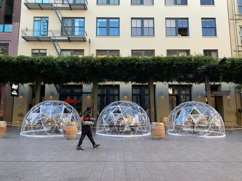 Igloo-like plastic dining bubbles line San Francisco's Mint Plaza outside sushi eatery Hashiri.