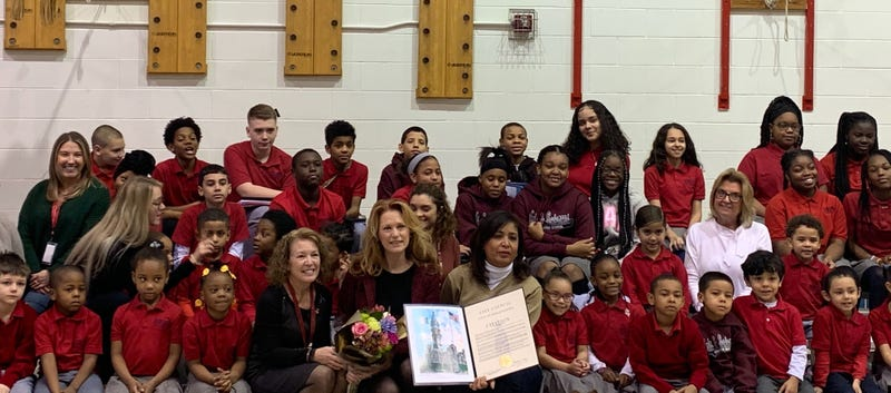 Lisa Weidman, a nurse at Philadelphia Charter School for Arts and Sciences, is honored for saving a student's life.