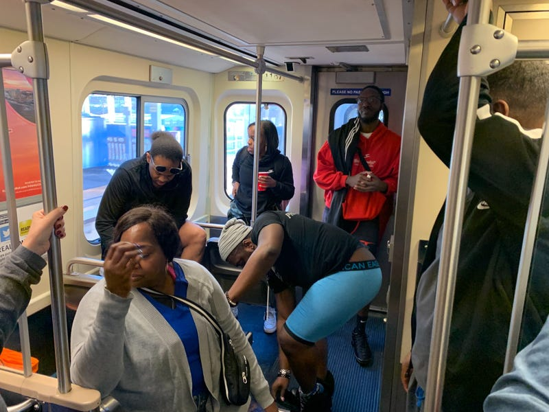 A Market-Frankford Line rider looks away as fellow passengers take part in the No Pants Subway Ride to benefit the homeless.