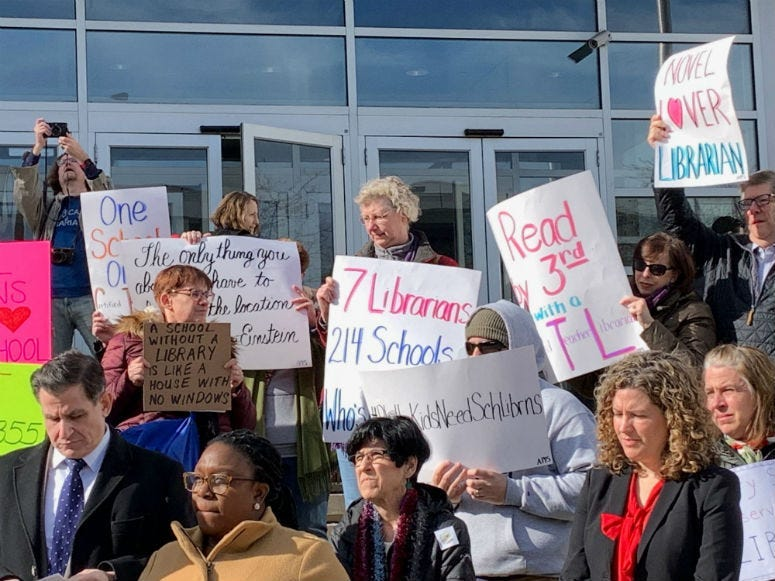 Educators rallied on the steps of Philadelphia School District headquarters, calling on schools to restore librarians to schools.