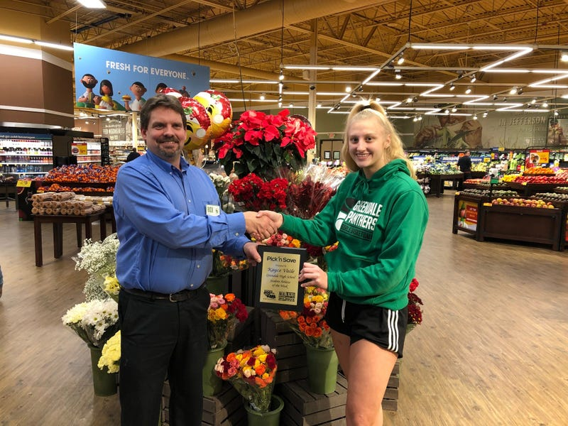 Kayce and 76th & Rawson Store Director Rick Kloth